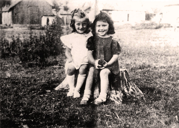 This photo of Nusia (white dress) and her cousin Hanna was taken by Roman Gdanski, probably in the summer of 1940. It is not known where the photo was taken.